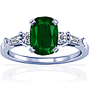 Cushion Emerald Prong Set Ring With Round And Tapered Baguette Cut Diamonds (2.06cttw)