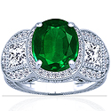 Oval Cut Emerald Prong Set Halo Ring With Princess Cut And Round Diamonds (3.52cttw)