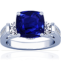 Rare Untreated Cushion Blue Sapphire Prong Set Three Stone Ring With Round And Princess Cut Diamonds (7.69cttw)