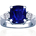 Rare Untreated Cushion Blue Sapphire Prong Set Three Stone Ring With Pear Shape Diamonds (8.07cttw)