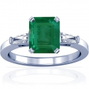 Emerald Prong Set Three Stone Ring With Tapered Baguette Cut Diamonds (3.96cttw)