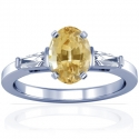 Rare Untreated Oval Cut Yellow Sapphire Prong Set Three Stone Ring With Tapered Baguette Cut Diamonds (1.50cttw)