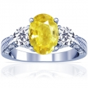 Oval Cut Yellow Sapphire Prong Set Three Stone Ring With Round Diamonds (1.46cttw)
