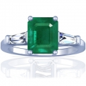 Emerald Prong Set Three Stone Ring With Tapered Baguette Cut Diamonds (2.78cttw)