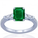 Emerald Prong Set Three Stone Ring With Round And Tapered Baguette Cut Diamonds (2.17cttw)