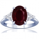 Oval Cut Ruby Prong Set Three Stone Ring With Trillion Cut Diamonds (1.52cttw)