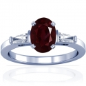 Oval Cut Ruby Prong Set Three Stone Ring With Tapered Baguette Cut Diamonds (1.35cttw)