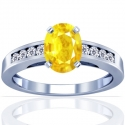 Oval Cut Yellow Sapphire Prong Set Ring With Round Diamonds (2.19cttw)