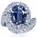 Rare Untreated Oval Cut Blue Sapphire Prong Set Ring With Round Diamonds (4.68cttw)